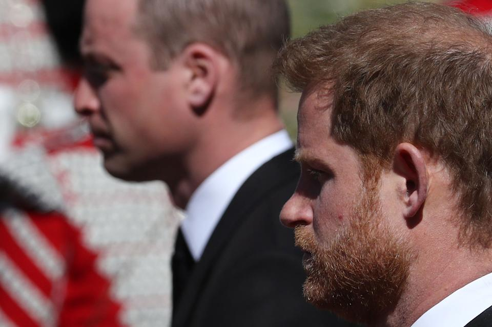 ALTERNATIVE CROP VERSION - Britain's Prince William, Duke of Cambridge (L) and Britain's Prince Harry, Duke of Sussex follow the coffin during the ceremonial funeral procession of Britain's Prince Philip, Duke of Edinburgh to St George's Chapel in Windsor Castle in Windsor, west of London, on April 17, 2021. - Philip, who was married to Queen Elizabeth II for 73 years, died on April 9 aged 99 just weeks after a month-long stay in hospital for treatment to a heart condition and an infection. - ALTERNATIVE CROP VERSION (Photo by Gareth Fuller / various sources / AFP) / ALTERNATIVE CROP VERSION (Photo by GARETH FULLER/AFP via Getty Images)
