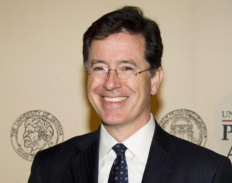 "FILE - In this May 21, 2012 file photo, TV personality and author Stephen Colbert attends the 71st Annual Peabody Awards in New York. Colbert, host of ""The Colbert Report,"" on Comedy Central,  will be a guest host on ""Good Morning America"" for Robin Roberts, who is scheduled to undergo a bone marrow transplant this week. (AP Photo/Charles Sykes, file)"