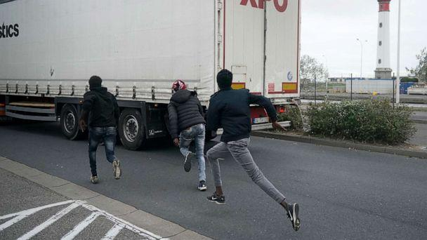 PHOTO: Migrants try to board a truck at Ouistreham ferry port in the hope of reaching the U.K. on Sept. 12, 2018, in Ouistreham, France. (Christopher Furlong/Getty Images, FILE)