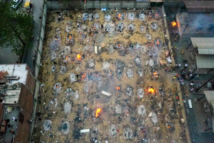 In this aerial picture taken on Monday, burning pyres of victims who lost their lives due to the coronavirus are seen at a cremation ground in New Delhi, India.
