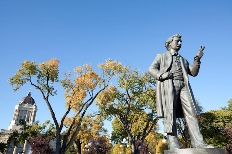 A sculpture of Louis Riel on the grounds of the Manitoba legislature. (Photo: mysticenergy via Getty Images)
