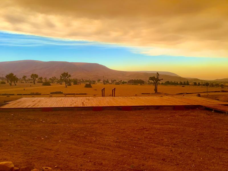 This photo from Sunday, Aug. 2, 2020 shows Pioneertown as it was engulfed by smoke from the Apple Fire. Pioneertown residents say conditions reminded them of the Sawtooth Complex Fire, which burned 70,000 acres across the High Desert in July 2006.