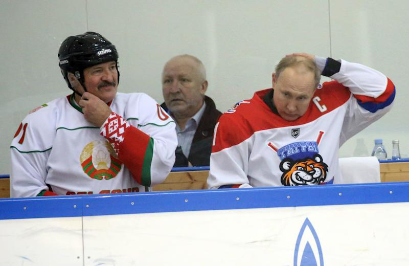 SOCHI, RUSSIA - FEBRUARY,7 (RUSSIA OUT) Russian President Vladimir Putin (R) and Belarussian President Alexander Lukashenko (L) attend an ice hockey match at Galaktika enternaoment center in Sochi, Russia, February,7,2020. Lukashenko and Putin is having a day of talks at mountain resort of Laura in Sochi. (Photo by Mikhail Svetlov/Getty Images)