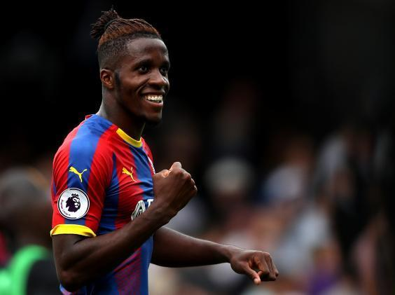 Wilfried Zaha signs new five-year contract with Crystal Palace after choosing not to pursue summer transfer