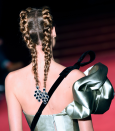 And you thought earrings were only for your ears? Make like the models at the Alexis Mabille spring couture show and wear them tucked into the ends of braided pigtails.