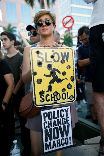A protester at the gun control rally in Fort Lauderdale, Florida. Marco refers to US Senator Marco Rubio of Florida, who has received millions in political help from pro-gun groups