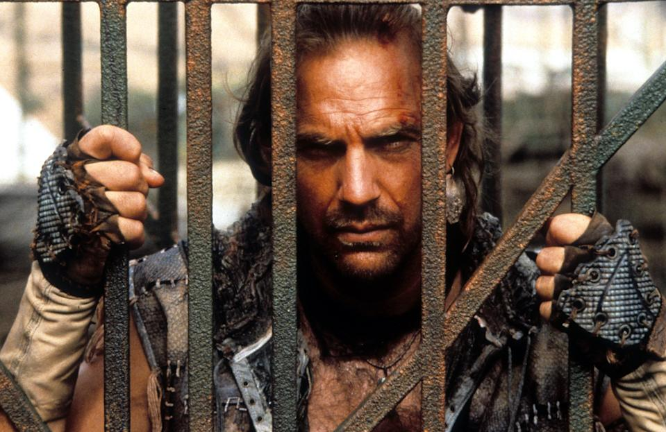 Kevin Costner behind bars in a scene from the film 'Waterworld', 1995. (Photo by Universal/Getty Images)