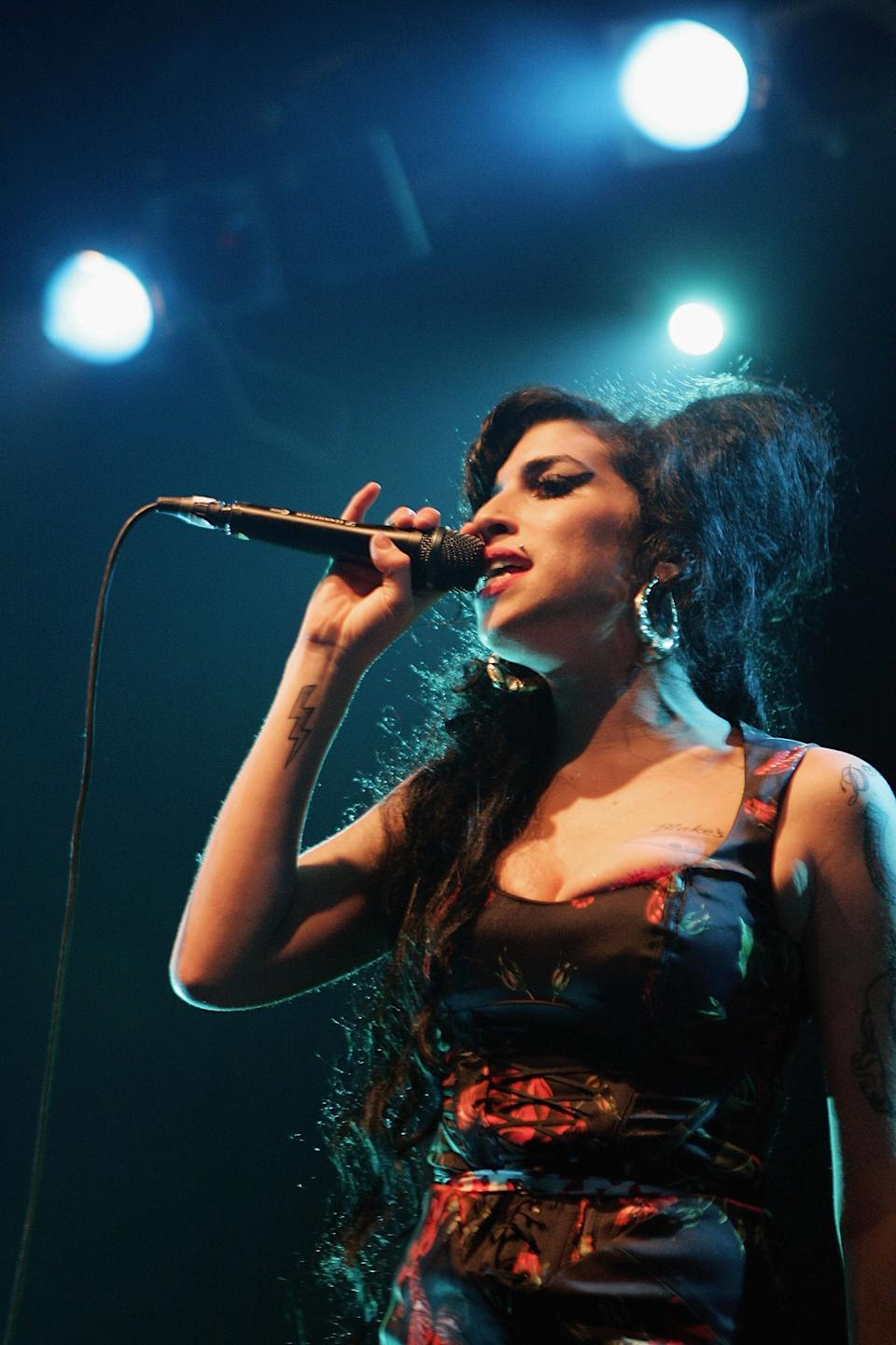 """<h1 class=""""title"""">Amy Winehouse</h1><cite class=""""credit"""">Photo: Getty Images</cite>"""