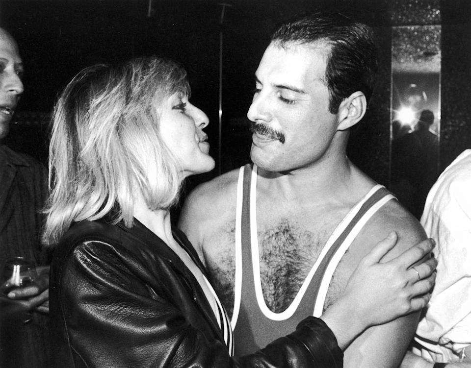 British singer, songwriter and record producer Freddie Mercury (1946 - 1991) of British rock band Queen with his friend Mary Austin, during Mercury's 38th birthday party at the Xenon nightclub, London, UK, September 1984. (Photo by Dave Hogan/Getty Images)