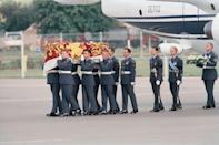 <p>Another media darling of the 90s, Princess Diana of Wales was fatally wounded in a car crash after being chased by paparazzi in August of 1997. This image shows her coffin arriving at RAF Northolt airport from Paris, where the accident took place.</p>