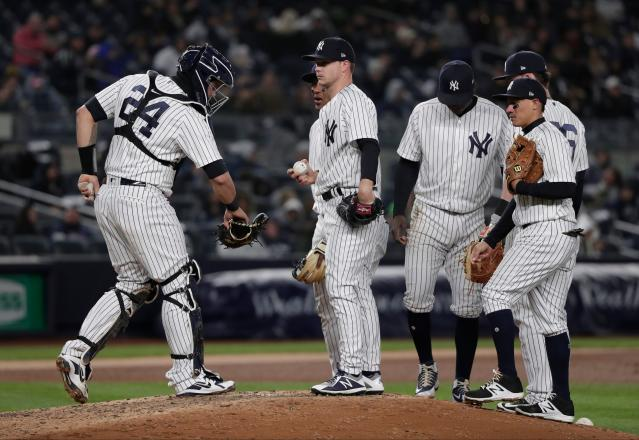 New York Yankees pitcher Sonny Gray, center, waits to be relieved after giving up two runs to the Toronto Blue Jays during the fourth inning of a baseball game, Friday, April 20, 2018, in New York. (AP Photo/Julie Jacobson)