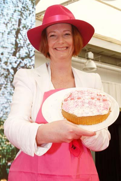 SYDNEY, AUSTRALIA - JANUARY 05:  Australian Prime Minister Julia Gillard displays a cake she made at a Jane McGrath High Tea during day three of the Second Test Match between Australia and India at Sydney Cricket Ground on January 5, 2012 in Sydney, Australia.  (Photo by Mark Metcalfe/Getty Images)