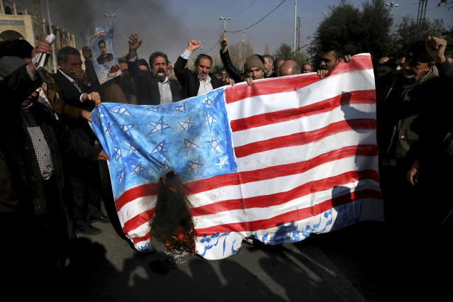 <p>Iranian worshippers chant slogans while they burn a representation of U.S. flag during a rally against anti-government protestors after the Friday prayer ceremony in Tehran, Iran, Jan. 5, 2018. (Photo: Ebrahim Noroozi/AP) </p>