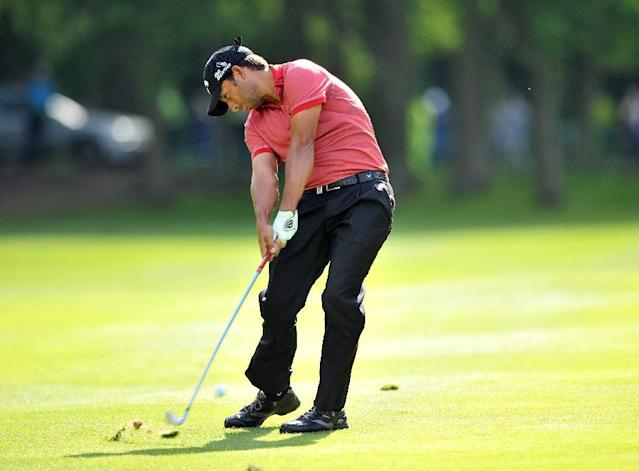 Spanish golfer Pablo Larrazabal plays his approach shot at Wentworth Golf Club in Surrey, England, on May 25, 2014 (AFP Photo/Glyn Kirk)