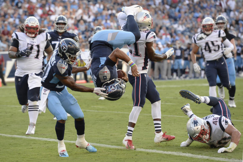 Tennessee Titans quarterback Marcus Mariota (8) flips into the end zone as he converts a two-point conversion against the New England Patriots. (AP)