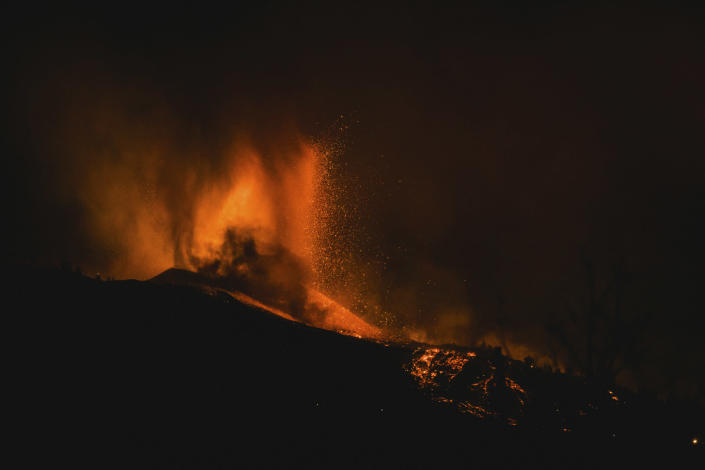 Lava flows from an eruption of a volcano near El Paso on the island of La Palma in the Canaries, Spain, in the early hours of Monday, Sept. 20, 2021. Lava continues to flow slowly from a volcano that erupted in Spain's Canary Islands off northwest Africa. The head of the islands' regional government says Monday he expects no injuries to people in the area after some 5,000 were evacuated. (AP Photo/Jonathan Rodriguez)