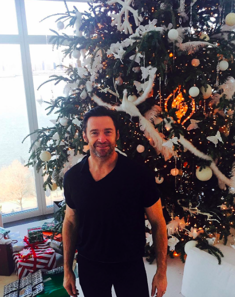 """<p>Hugh Jackman struck a pose in front of his enormous Christmas tree and posted a special holiday greeting: """"Merry Christmas to you and yours …"""" (Photo: <a rel=""""nofollow noopener"""" href=""""https://www.instagram.com/p/BOcqv4WjJGl/"""" target=""""_blank"""" data-ylk=""""slk:Instagram"""" class=""""link rapid-noclick-resp"""">Instagram</a>) </p>"""