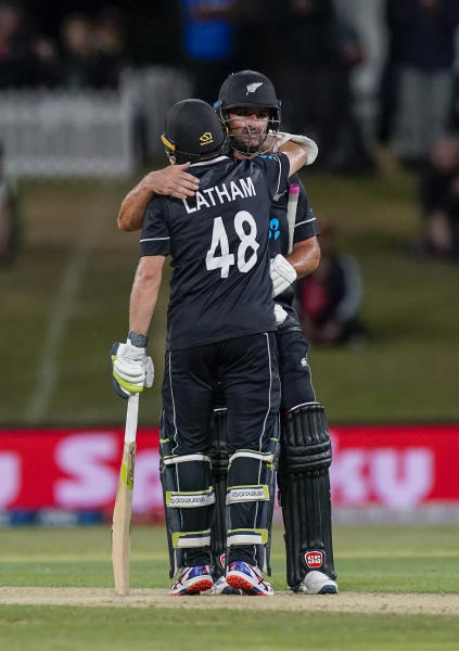 New Zealand's Colin de Grandhomme and Tom Latham celebrate the win during the One Day cricket international between India and New Zealand at Bay Oval, Tauranga, New Zealand, Tuesday, Feb. 11, 2020. (John Cowpland/Photosport via AP)