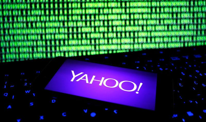 FILE PHOTO: A photo illustration shows a Yahoo logo on smartphone in front of a displayed cyber code and keyboard