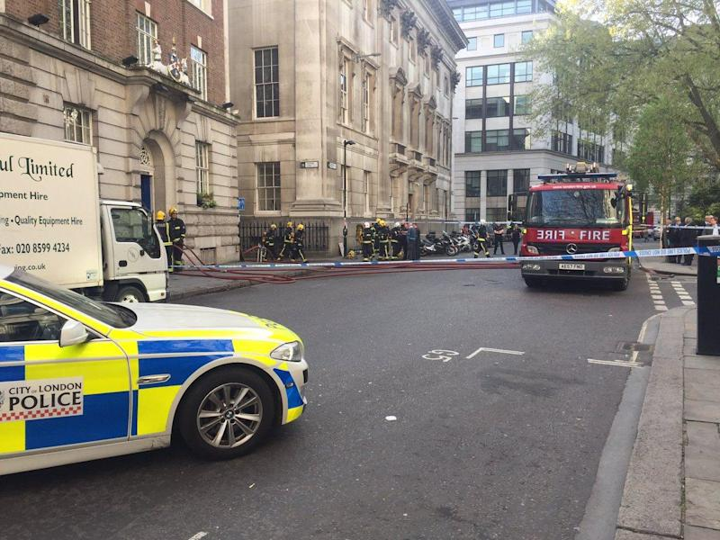 Roads around Gresham Street have been cordoned off as a result of the fire: @CityPolice