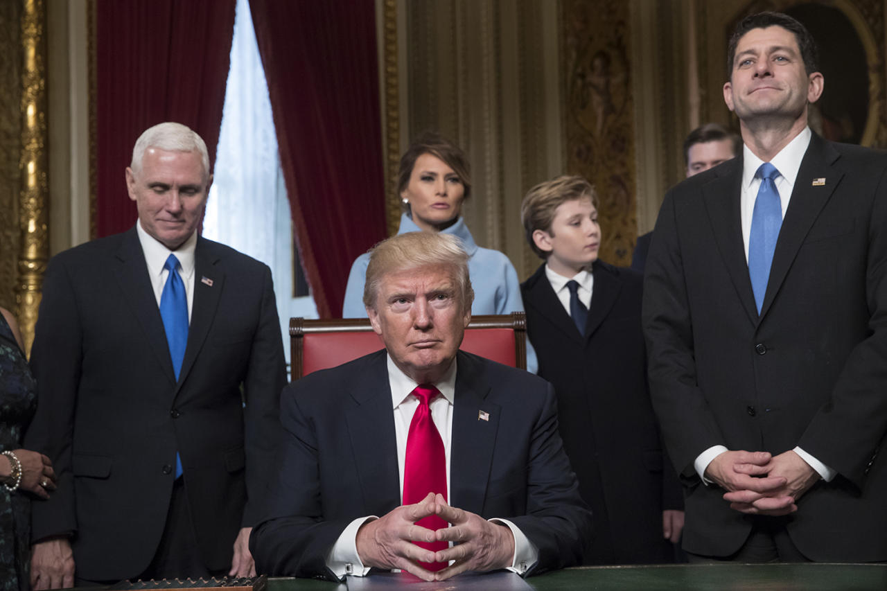 <p>President Donald Trump is joined by the Congressional leadership and his family before formally signing his cabinet nominations into law, Friday, Jan. 20, 2107, in the President's Room of the Senate on Capitol Hill in Washington. From left are, Vice President Mike Pence, the president's wife Melania Trump, their son Barron Trump, and House Speaker Paul Ryan of Wis. (Photo: J. Scott Applewhite, Pool/AP) </p>