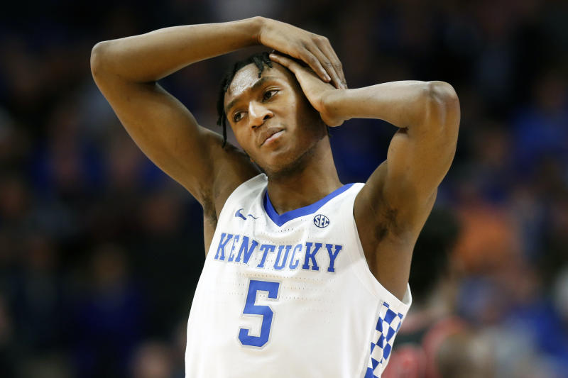 Kentucky's Immanuel Quickley holds his ear after being elbowed during an NCAA college basketball game against Georgia's in Lexington, Ky., Tuesday, Jan 21, 2020. Kentucky won 89-79. (AP Photo/James Crisp)