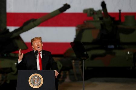 U.S. President Donald Trump speaks to workers in front of U.S. Army tanks on display at the Lima Army Tank Plant (LATP) Joint Systems Manufacturing Center, the country's only remaining tank manufacturing plant, in Lima, Ohio, U.S., March 20, 2019. REUTERS/Carlos Barria