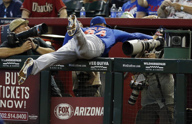 Chicago Cubs' Anthony Rizzo makes a diving catch into the photo well on a foul ball hit by Arizona Diamondbacks' Aaron Hill during the sixth inning of a baseball game on Sunday, July 20, 2014, in Phoenix. (AP Photo/Ross D. Franklin)