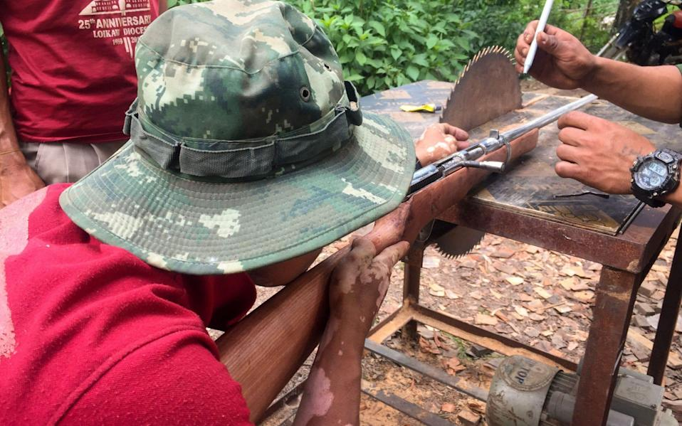 Members of the People's Defence Force (PDF) make handmade guns to be used in fighting against security forces
