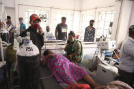 Patients use oxygen cylinders in hospital after a leakage in the oxygen plant in Nashik, in the Indian state of Maharashtra, Wednesday, April 21, 2021. A local administrator in western India says 22 patients have died in a hospital when their oxygen supply was interrupted by a leakage in a supply tank. The official says the oxygen supply has since been resumed to other patients. (AP Photo)