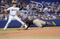 San Diego Padres' Tommy Pham, right, is safe at third as Miami Marlins third baseman Brian Anderson waits for the throw during the second inning of a baseball game, Sunday, July 25, 2021, in Miami. (AP Photo/Lynne Sladky)