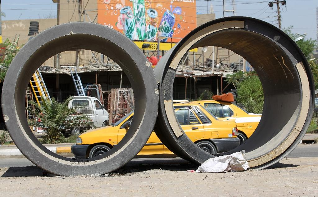 Sewage pipes in a street of Iraq's capital whose people have for years denounced bad management and financial negligence that have let the country's infrastructure fall apart despite the injection of billions of dollars (AFP Photo/Ahmad al-Rubaye)