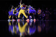 The Los Angeles Sparks huddle before their WNBA basketball game against the Connecticut Sun Thursday, Sept. 9, 2021, in Los Angeles. (AP Photo/Ashley Landis)