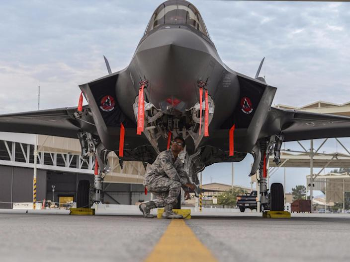 Airman 1st Class Eric Ruiz-Garcia, 63rd Aircraft Maintenance Unit crew chief, performs an inspection on an F-35A Lightning II at Luke Air Force Base, Arizona, December 1, 2017.