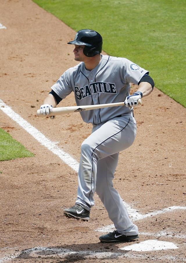 Seattle Mariners catcher Mike Zunino (3) reacts after striking out in the fourth inning of a baseball game against the Atlanta Braves Wednesday, June 4, 2014 in Atlanta. Seattle won 2-0. (AP Photo/John Bazemore)