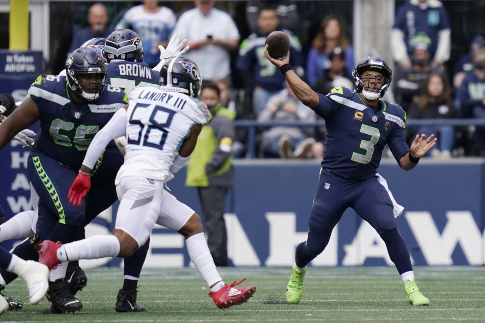 Seattle Seahawks quarterback Russell Wilson (3) passes to wide receiver Freddie Swain (not shown) for a touchdown against the Tennessee Titans during the second half of an NFL football game, Sunday, Sept. 19, 2021, in Seattle. (AP Photo/Elaine Thompson)