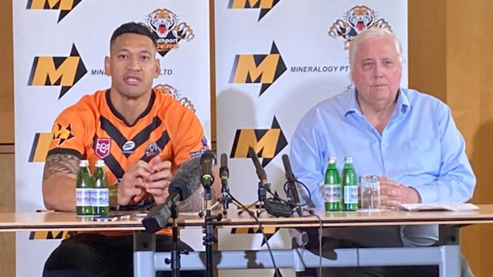 Clive Palmer (pictured right) sits next Israel Folau (pictured left) in a media conference for the Southport Tigers.