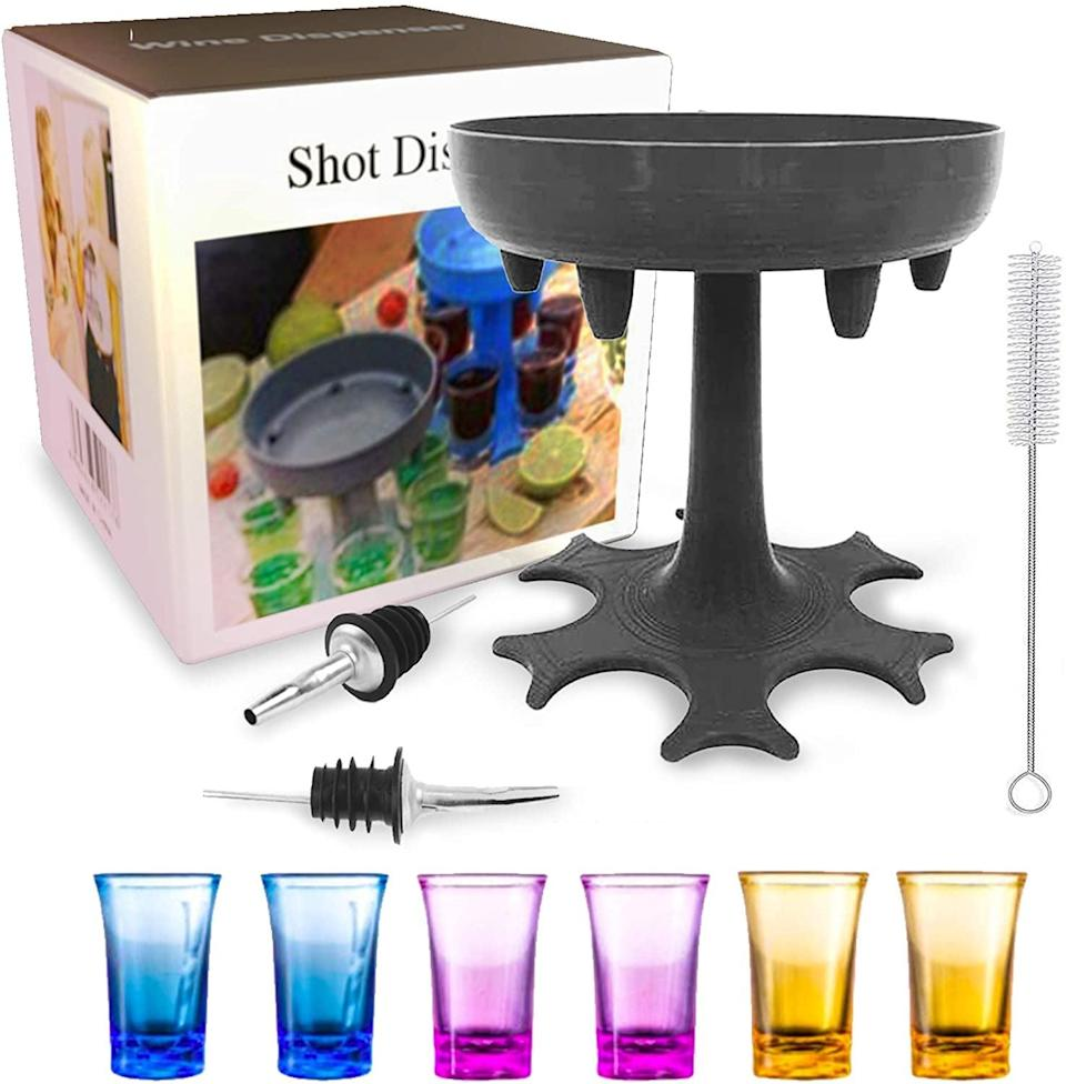 <p>The <span>Shot Glass Dispenser Holder Set </span> ($15) let's you pour six shots at once.</p>
