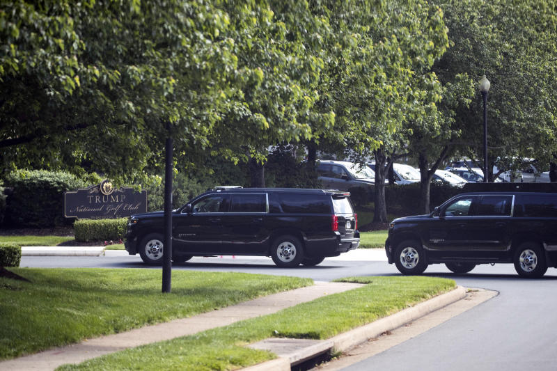 The motorcade for President Donald Trump arrives at Trump National Golf Club, Saturday, May 23, 2020, in Sterling, Va. (AP Photo/Alex Brandon)