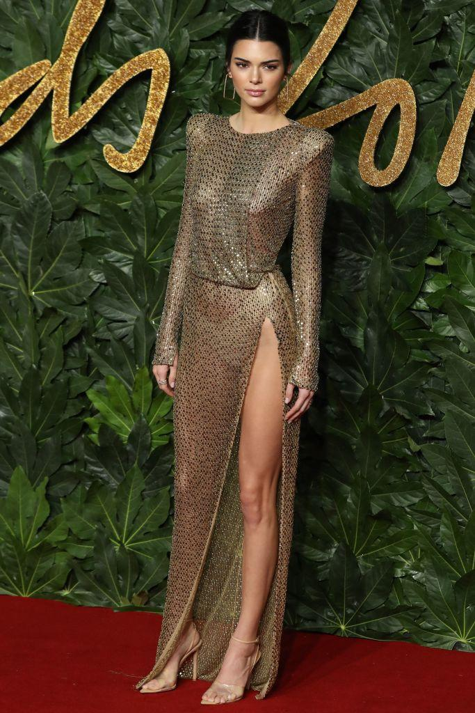 <p>Not one to shy away from the naked dress trend, Kendall Jenner stuck to her sartorial know-how in a sheer thigh-high split dress with gold accessories. <em>[Photo: Getty]</em> </p>