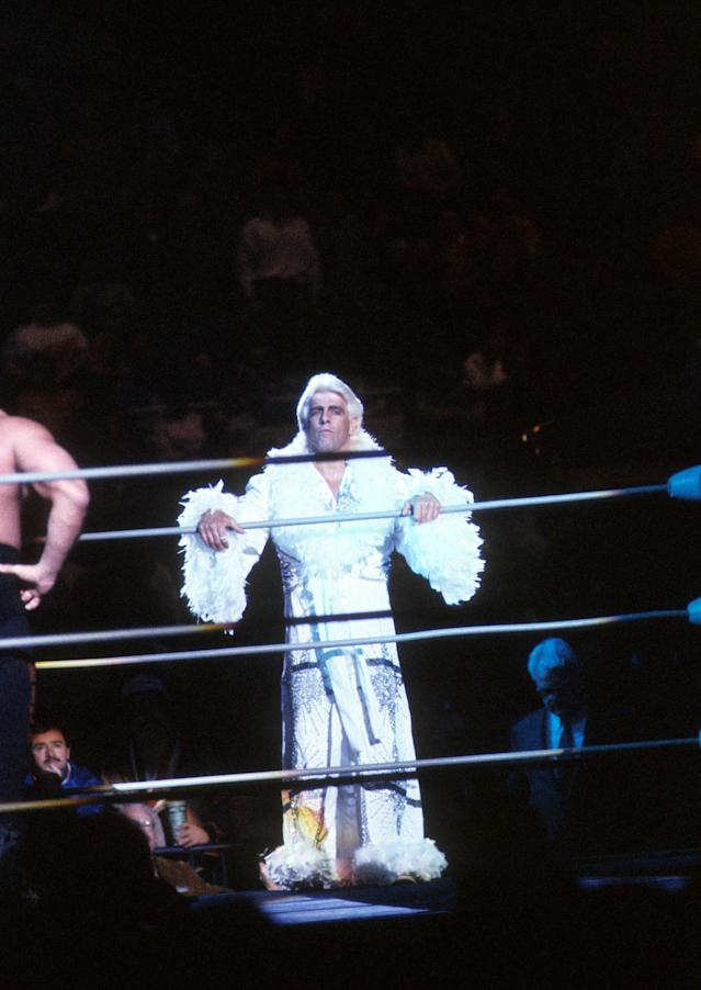 "<p>The ""Nature Boy"" Rick Flair steps into the ring before his Heavy Weight bout against Road Warrior Hawk during the 1988 Bunkhouse Stampede on January 24, 1988 at the Nassau Coliseum in Uniondale, New York. (Photo by B Bennett/Getty Images) </p>"