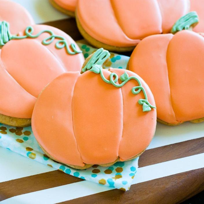 """<p>Re-create these adorable iced cookies this fall! They're made with pumpkin puree and spices like nutmeg, allspice, and cloves.</p><p><strong><a href=""""https://www.thepioneerwoman.com/food-cooking/recipes/a79957/spiced-pumpkin-cut-out-cookies/"""" rel=""""nofollow noopener"""" target=""""_blank"""" data-ylk=""""slk:Get the recipe."""" class=""""link rapid-noclick-resp"""">Get the recipe.</a></strong> </p>"""
