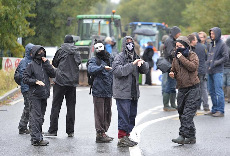 Masked opponents against the airport project near Notre-Dame-des-Landes demonstrate on September 22, 2015 (AFP Photo/Jean-Francois Monier)