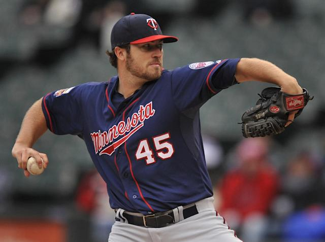Minnesota Twins starter Phil Hughes delivers a pitch during the first inning of a baseball game against the Chicago White Sox in Chicago, Thursday, April 3, 2014. (AP Photo/Paul Beaty)