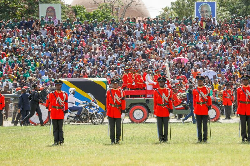 Military officers escort a gun carriage carrying the coffin of late Tanzanian President Magufuli draped in the national flag, during the State Funeral Procession at the Jamhuri Stadium in Dodoma
