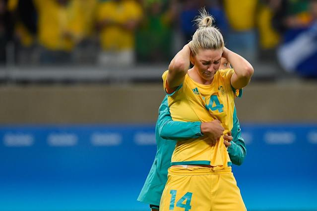 <p>Alanna Kennedy of Australia is embraced after their 0-0 (6-7 PSO) loss to Brazil during the Women's Football Quarterfinal match at Mineirao Stadium on Day 7 of the Rio 2016 Olympic Games on August 12, 2016 in Belo Horizonte, Brazil. (Photo by Pedro Vilela/Getty Images) </p>