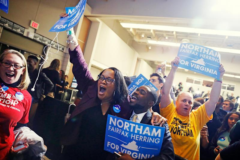 Supporters of Democratic gubernatorial candidate Ralph Northam celebrate as results start to come in at Northam's election night rally on the campus of George Mason University in Fairfax, Virginia, on Nov. 7.  (Aaron Bernstein / Reuters)
