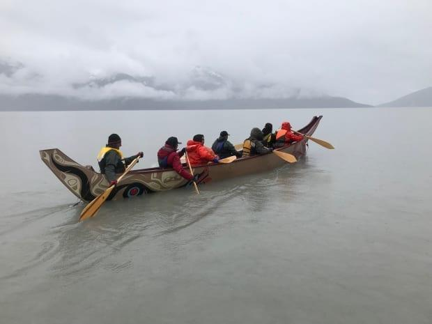 Paddlers on a misty day on the Taku River. The boat followed the same route taken by Tlingit for hundreds of years.  (Mike Rudyk/CBC - image credit)