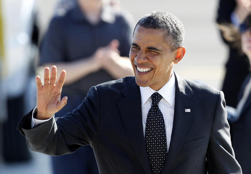 President Barack Obama waves to supporters on his arrival at Boeing Field Tuesday, July 24, 2012, in Seattle. Obama is scheduled to attend a pair of campaign fund-raisers in the area. (AP Photo/Elaine Thompson)