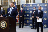 U.S. Attorney Mike Hurst announces Thursday, Aug. 6, 2020, in Jackson, Miss., the indictments of four executives from two Mississippi poultry processing plants on federal charges tied to one of the largest workplace immigration raids in the U.S. in the past decade. Thursday's announcement was made a day before the one-year anniversary of the raids in which 680 people were arrested at seven poultry plants in central Mississippi. (AP Photo/Rogelio V. Solis)